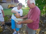 AnnCherie (Kelly) Dye and David Dye pouring out coconut water.  Hummmmm good!